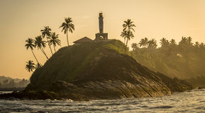 Light house on rock. Along the coast of Sri Lanka just after sunrise Royalty Free Stock Images