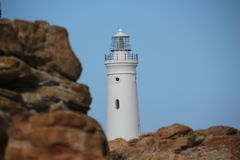 Light House and Rocks Royalty Free Stock Photos