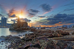 Light House at sea Cove at Sunset Stock Image