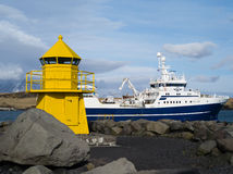Light house Seltjarnarnes harbour fishing vessel iceland Royalty Free Stock Photo