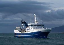 Light house Seltjarnarnes harbour fishing vessel iceland Stock Images