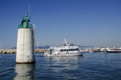 Light house & ships in the port of cannes Stock Photo