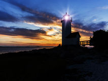 Light house. Silhouette of lighthouse off the coast of New England Royalty Free Stock Photography