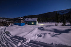 The light from the house in snowy Siberia. In Russia royalty free stock images