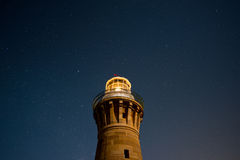Light house under star. Royalty Free Stock Photos