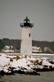 Light house in Winter in New Castle NH Stock Image