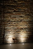 Light illuminating a brick wall Royalty Free Stock Images