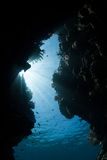 Light Illuminating Underwater Crevice Stock Photography