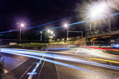 Light illusions created on lit up roads at night Stock Photo