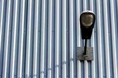 Light on industrial. A street lighting on an industrial building. light and shadow Stock Photography