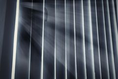 Light infiltrating in the cloud, shaded by the handse royalty free stock photo