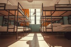 Light inside bedroom of a youth hostel with bunk beds for asleep tourists and students Stock Images