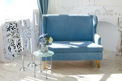 Light interior in the fusion style with velvet sofa of the sea wave color Royalty Free Stock Photo