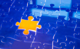 Light irradiation Jigsaw. Missing jigsaw puzzle with ray of light coming out from the background, business concept for completing the final puzzle piece stock photography