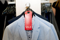 Light jacket with a shirt on a hanger. Light jacket with a shirt on a hanger in the store Royalty Free Stock Photos