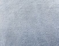 Light jeans. Light blue jeans close up as textured background Royalty Free Stock Photo