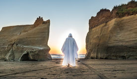 Light of Jesus. Jesus walking between to cliffs into the light Stock Photography