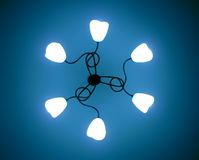 Light lamp abstract. Light - abstract lamp. Lamp on ceiling. Blue light. Abstract looking light lamp. Main light with 6 small lamp light stock image