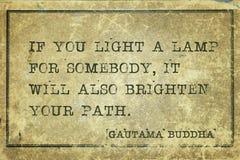Light a lamp Buddha stock image