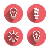 Light lamp icons. Energy saving symbols Royalty Free Stock Photos