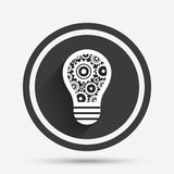 Light lamp sign icon. Bulb with gears symbol. Royalty Free Stock Photography