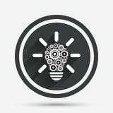 Light lamp sign icon. Bulb with gears symbol. Stock Images