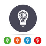 Light lamp sign icon. Bulb with gears symbol. Stock Photo