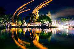 Light lampions at night above buddhist temple in Sukhothai histo Stock Images
