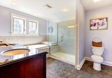 Light lavendar bathroom with large shower. Large nice lavendar bathroom with nice shower, tub and sink stock photo