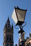 Light of Learning. A lamp and the tower at Glasgow University Stock Image