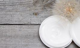 Light like a dandelion skin care cream background Stock Image