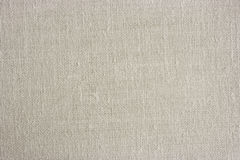 Light linen canvas texture. High resolution white canvas textile background Stock Images