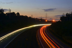 Light lines on road. Light lines on the road, left by passing cars Stock Image