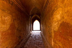 The light at long underground brick wall tunnel abstract backgro Stock Image