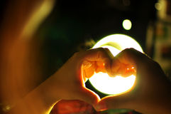 Light love hand Stock Photography