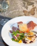 Light lunch. Starter with wine at restaurant Royalty Free Stock Photo
