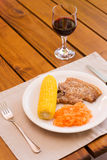 Light lunch served with red wine. Light lunch served with a glass of red wine Royalty Free Stock Image