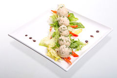 Light lunch wiht rice patties and salad. Rice patties and salad in a square dish on white Stock Photos