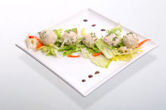 Light lunch wiht rice patties and salad. Rice patties and salad in a square dish on white Stock Photo