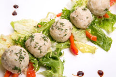 Light lunch wiht rice patties and salad. Rice patties and salad in a square dish on white Royalty Free Stock Photo