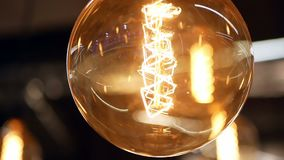 Light macro lamp decoration. Light bulbs garland close up. Electric bulb stock footage