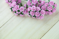 Light magenta roses in wood  background Royalty Free Stock Images