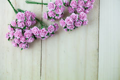 Light magenta roses in wood  background Stock Photos