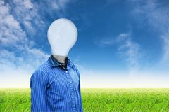 Light man on grass sky background 33 Royalty Free Stock Photo