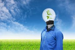 Light man on grass sky background Royalty Free Stock Image