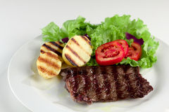 Light meal. Beef with baked potato, lettuce and tomato Stock Image