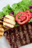Light meal. Beef with baked potato, lettuce and tomato Royalty Free Stock Photography
