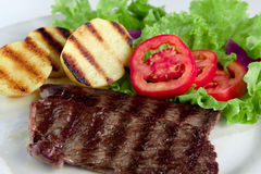 Light meal. Beef with baked potato, lettuce and tomato Stock Images