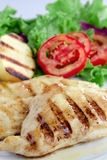 Light meal. Chicken with baked potato, lettuce and tomato Royalty Free Stock Images