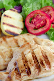Light meal. Chicken with baked potato, lettuce and tomato stock image